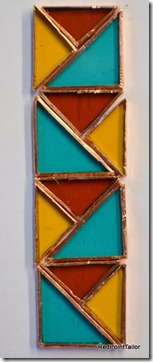 Working on Art Deco inspired Pendant - see green, orange and gold stained glass wrapped in copper foil