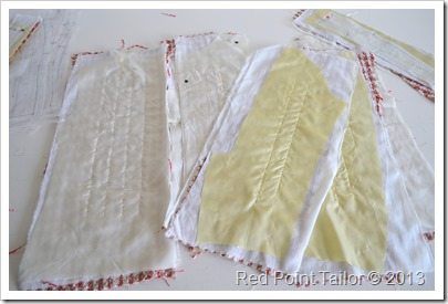 working on French jacket - basting the underlining to a fashion fabric, marking all notches, quilting the linign to a fashion fabric