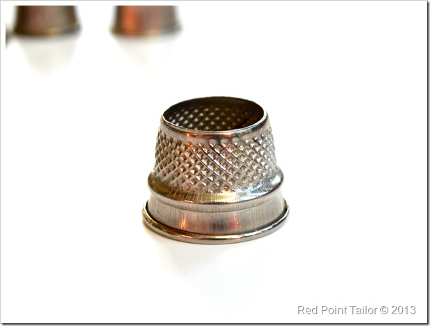 man thimble sewing supplies