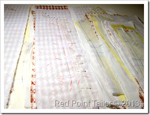 working on French jacket - basting the underlining to a fashion fabric, marking all notches